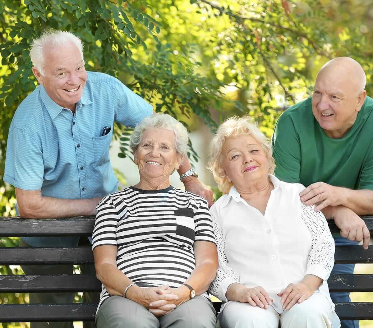 two senior couples enjoying the outdoors
